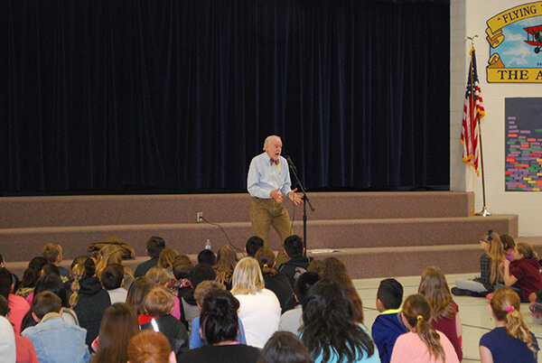 storyteller engages large group of students in story