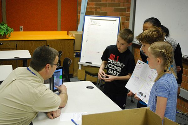 students present their projects to man