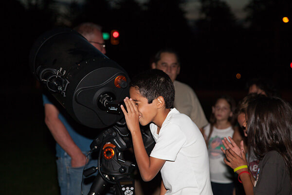 provost student looking through telescope