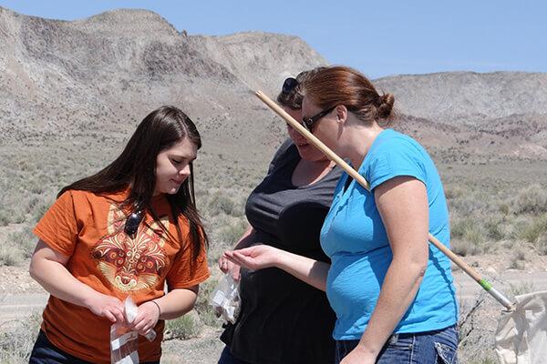 Educators examining rock materials
