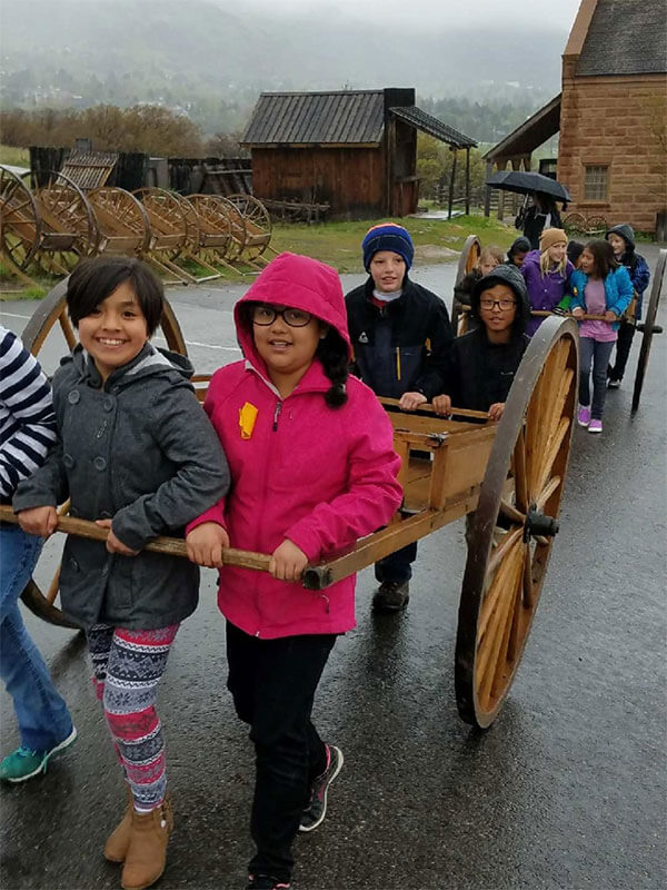 Timpanogos students pushing handcart