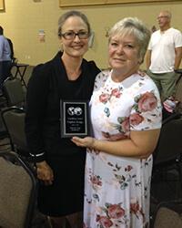 Daphne Budge receiving award