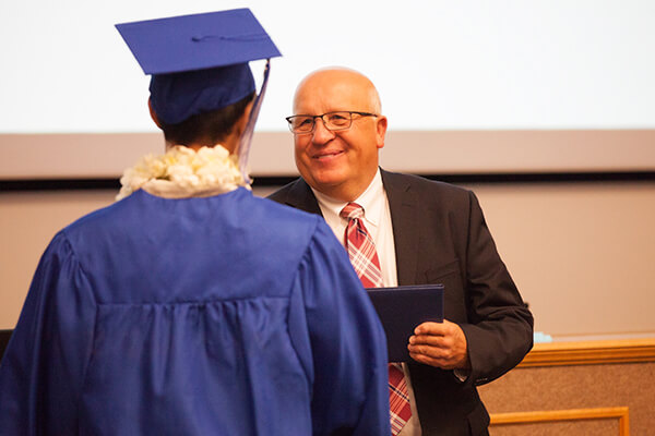 student receiving diploma