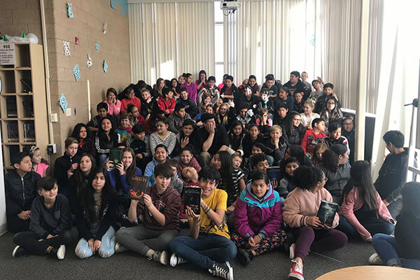 group photo of students who gathered to listen to author speak