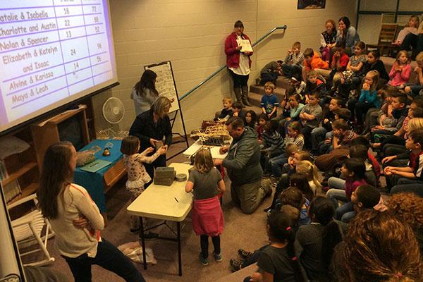 students and teachers test bridges