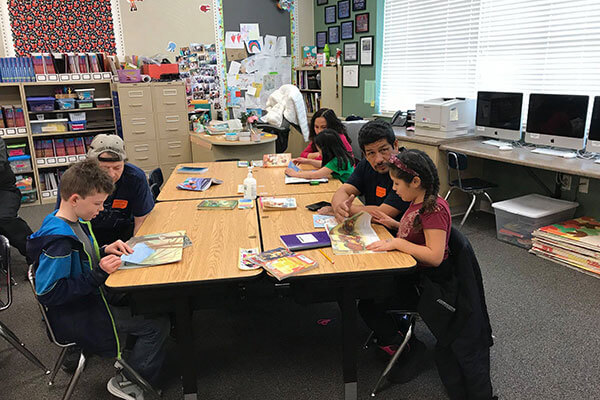 parents work with students in classroom