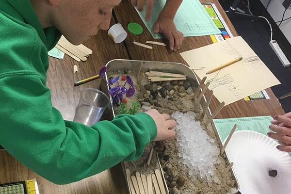 students build barrier for erosion experiment