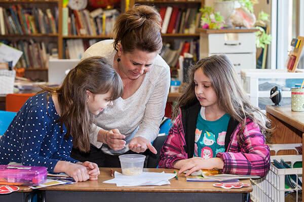 teacher helps students