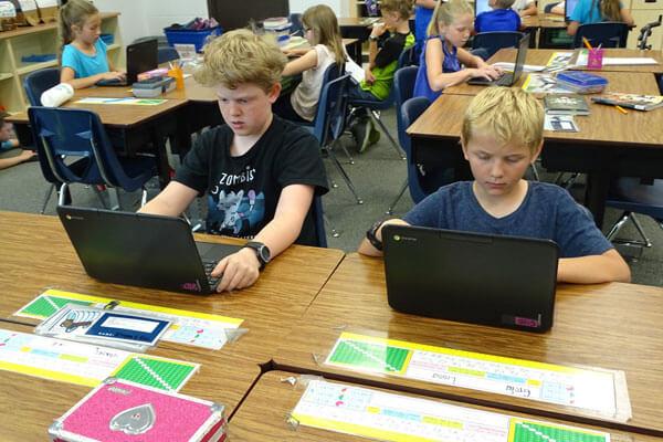 students work on chromebooks