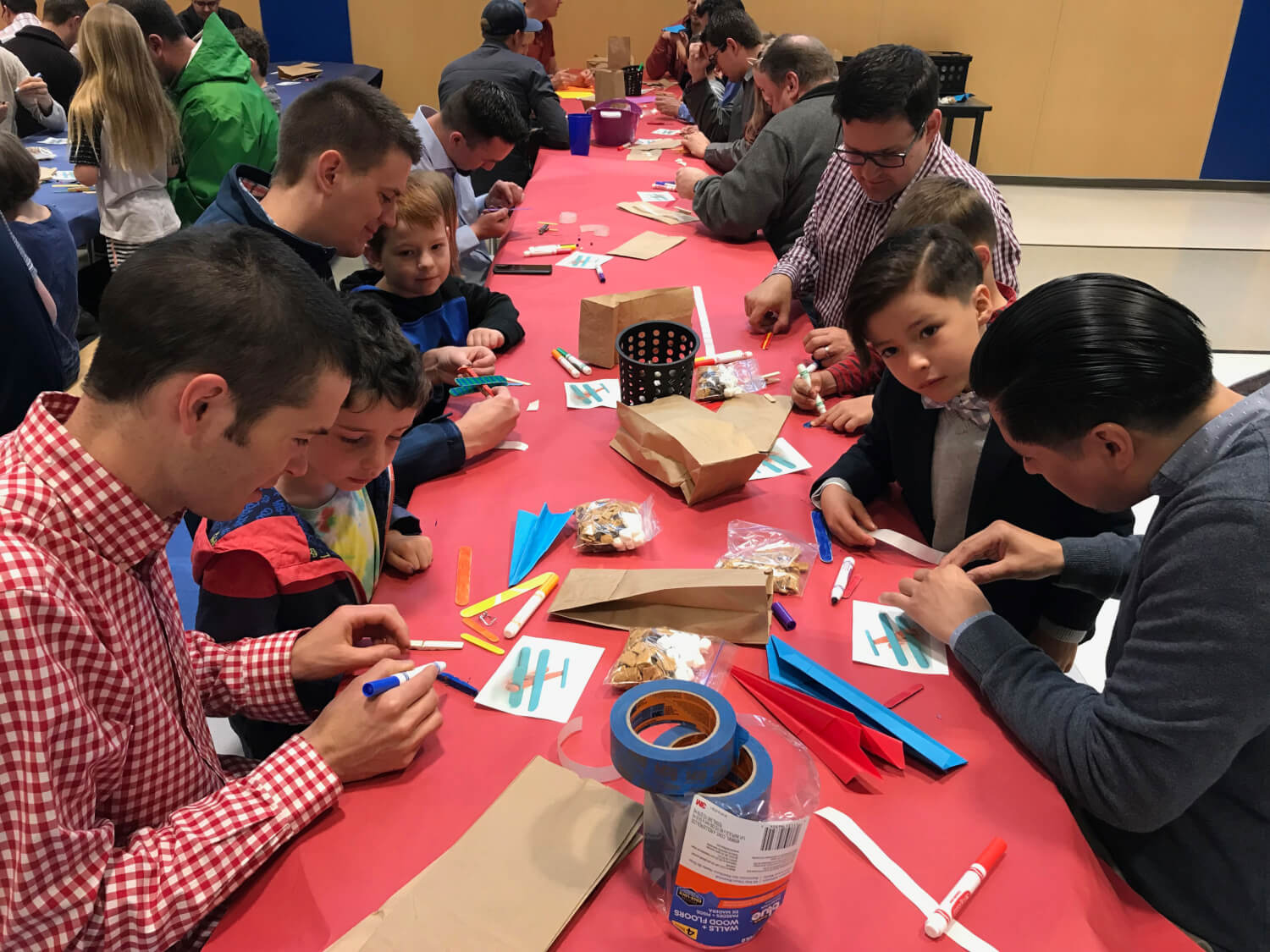 dads and students work on planes