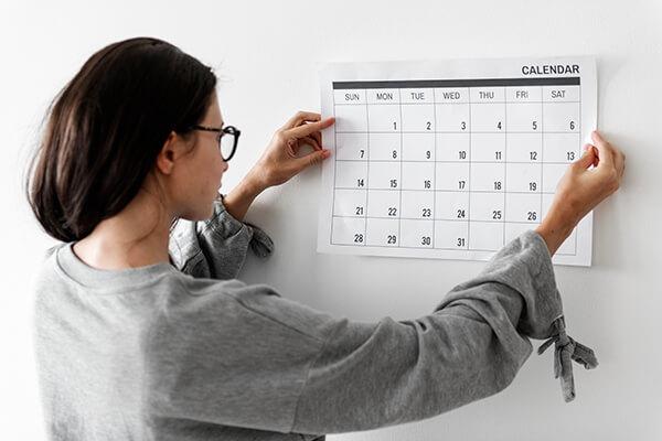 woman looking at calendar