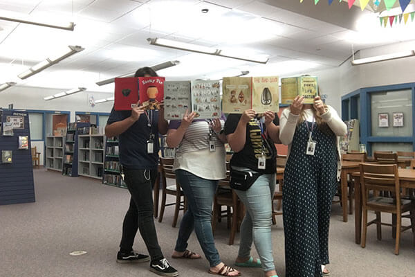teachers holding books