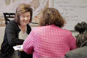 Teacher instructs adult student