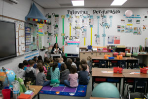 1st Graders gather on floor to learn