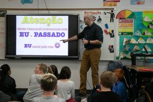 6th grade teacher instructs using a smart board